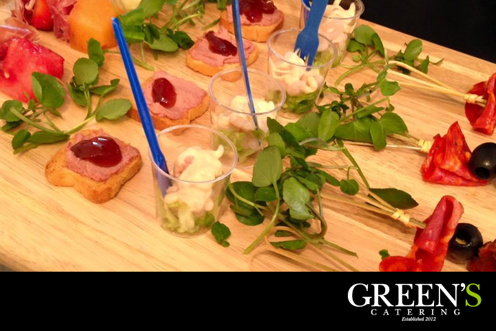 An assortment of tasty canapes presented on a wooden board.